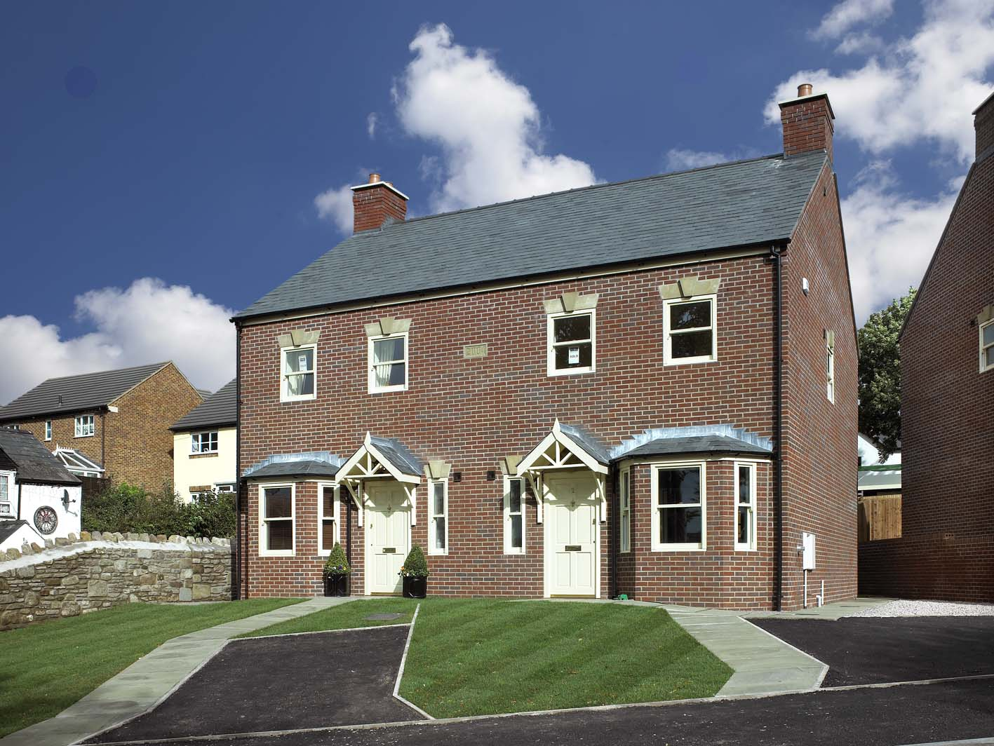 New detached and semi-detached houses on Greenfield site in Coleford, Gloucestershire.